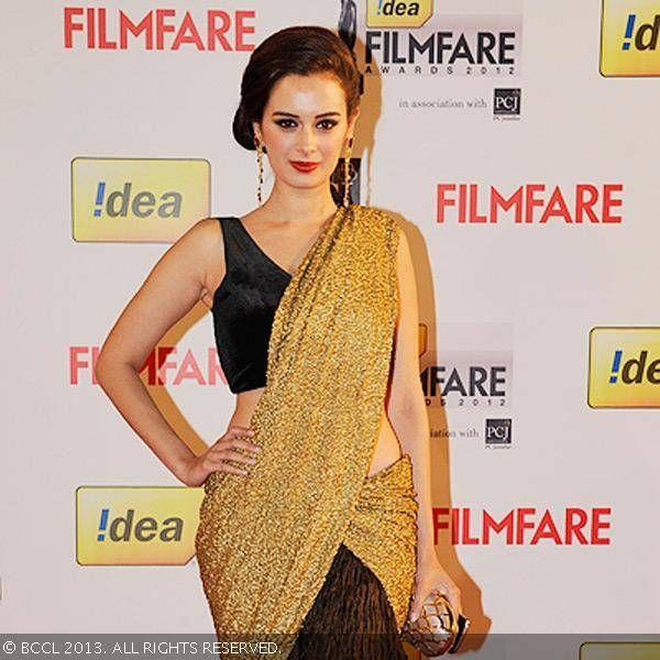 Evelyn Sharma in Nikhil Thampi brown designer half saree with gold designer dupatta and sleeveless blouse.