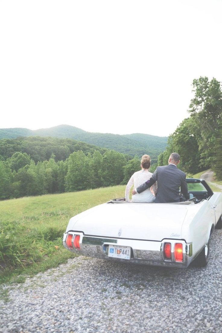 Vintage convertible getaway car https://www.thecelebrationsociety.com/weddings/purple-outdoor-wedding-mountain-laurel-farm-cleveland-ga/