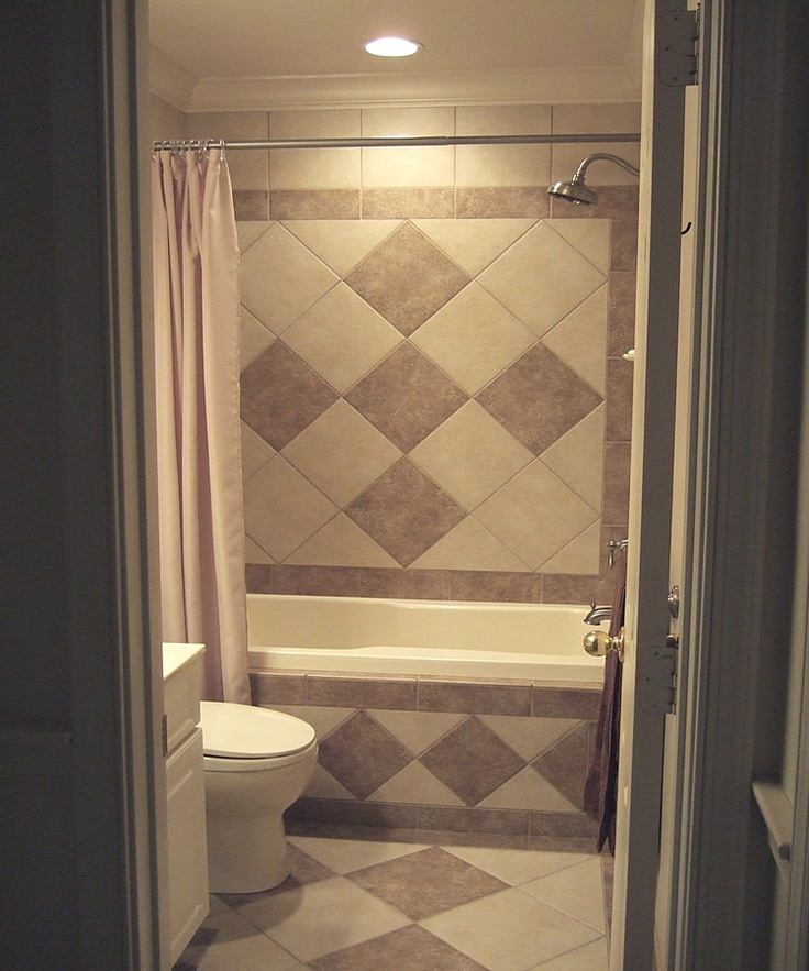 Shower wall on diagonal worked out to the full half with balance border notice no skirt on - Bathroom tiled walls design ideas ...