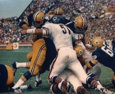 dick butkus vs packers - seriously awesome picture, looks like he is taking out 3 Packers at once.