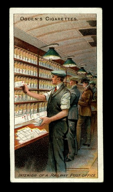 "Cigarette Card - Inside a Railway Post Office Ogden's Cigarettes ""Royal Mail"" (series of 50 issued in 1909) #33 Interior of a railway Post Office"