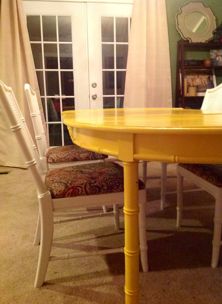 Bright yellow dinning table with white chairs and fun cushions! DIY inspired!