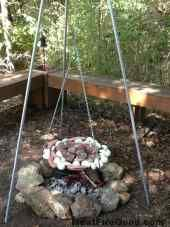 A traditional schwenker meal swinging on a schwenker grill over oak coals.