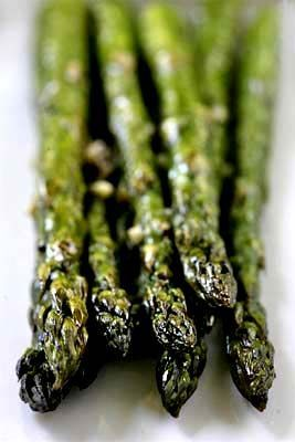 Quick and easy roasted asparagus recipe, with thick asparagus spears, olive oil, garlic, salt, pepper, and a little lemon juice.