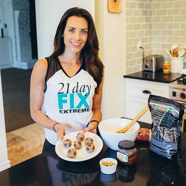 "Shakeology Cookie Dough Bites= best #cleancheat ever! They are the perfect snack for a busy schedule, so easy to pack up and take with you-- they're also a great healthy ""treat"" to throw in your little ones school lunches! I know my Little Man loves them! Here's how you make them: Vanilla Cookie Dough Bites ½ cup all-natural almond butter ¼ cup raw honey ½ cup finely chopped raw almonds 2 ½ scoops Vanilla Shakeology 2 Tbsp. mini semi-sweet (or dark chocolate) chocolate chips 1. Combine…"