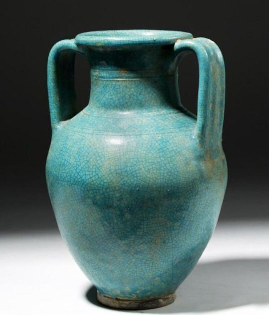 Parthian Glazed Pottery Amphora, 1st-3rd Century AD    A striking, wheel-made ceramic vase of a classic amphora form. The beautiful turquoise glaze presents lovely craquelure, its color, largely due to the presence of copper oxide in an alkaline base in the glaze, was most likely made to imitate Chinese celadon ware.