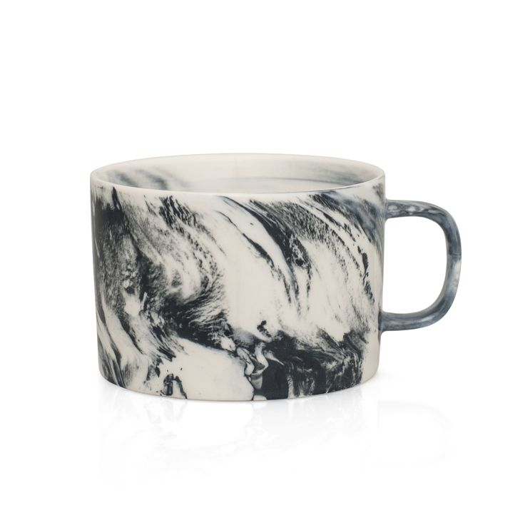 Marble is a modern porcelain tabletop collection. The marbled effect is created when natural clay and coloured clay are poured into the mould together and mix organically, creating unique pieces. Every piece created is unique as the two types of clay mix organically, meaning the pattern is never the same twice.