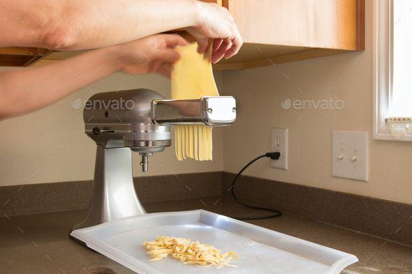Man making homemade fettuccine pasta. http://photodune.net/item/man-making-homemade-fettuccine-pasta/11115561