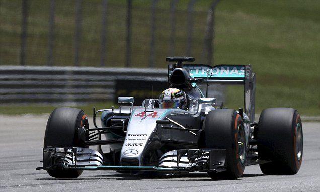 Lewis Hamilton on pole for Malaysian Grand Prix #DailyMail