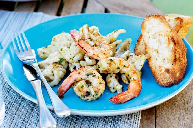 Preparing your Christmas menu? Add prawns and calamari to your shopping list to create this gourmet starter.