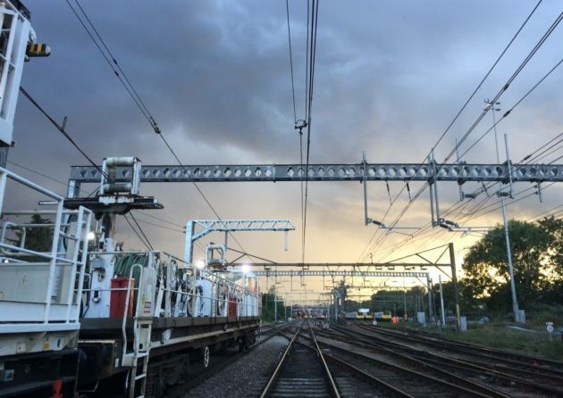 Engineers working on overhead wires at Gidea Park on the rail line to London. Picture: NETWORK RAIL