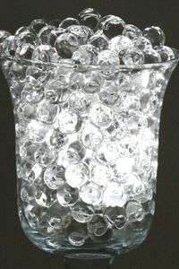 Jelly decor water pearls - just add water and they grow to fill a vase or fishbowl. Also available in blues or greens or add a battery operated colored light in the bottom of the vase for your own color.