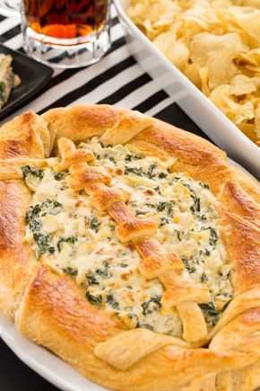 SUPER BOWL SUNDAY PARTY FOOD: Score major points this Super Bowl with this easy and delish football dip idea! You'll need Pillsbury French bread dough, this kale-artichoke dip, and eggs to create this super easy and fun dish. Click through to find more simple and delicious snack ideas for your Super Bowl party.