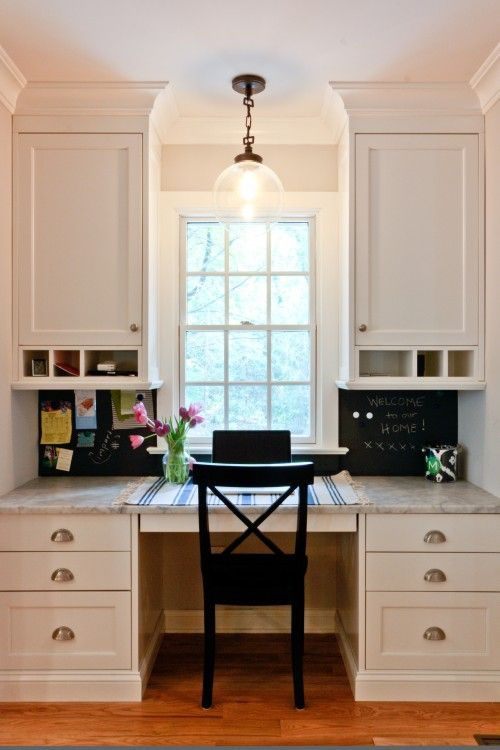 The desk area in the kitchen serves as a perfect spot to leave messages and important information. Magnetic primer and chalkboard paint make a great backsplash and the built-in cabinetry blend seamlessly with the rest of the kitchen.