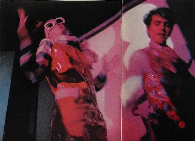 1966 vintage photo Tiger Morse in plastic jumpsuit with friend at nightclub discotheque
