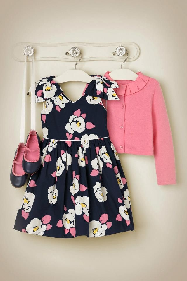 A place to hang outfit for the next day. You could easily make a ribbon with little clamps on each end to hold the shoes, too. :)