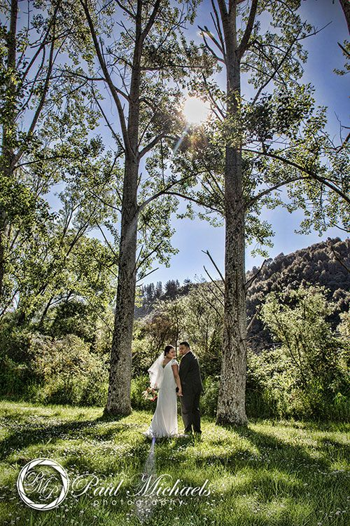 Bride and groom at the Hutt river. New Zealand #wedding #photography. PaulMichaels of Wellington www.paulmichaels.co.nz