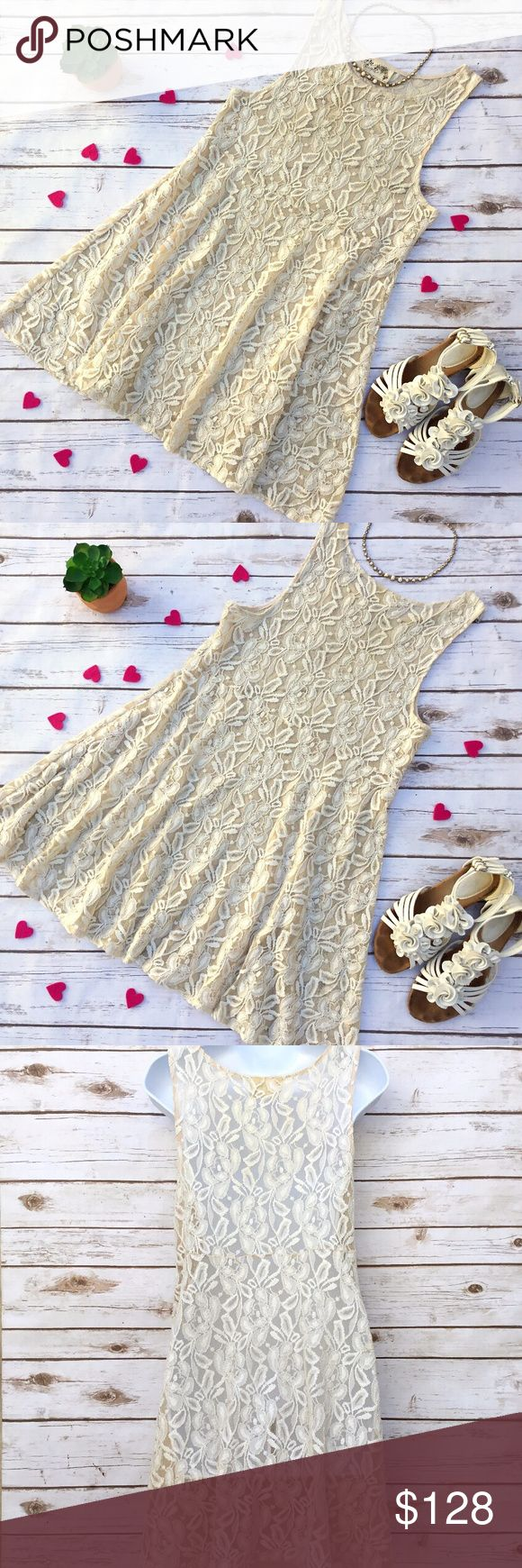 Free People Miles of Lace Nude Festival Dress Romantic and very feminine dress. This one does not include a slip. 73% cotton and 27% nylon. Size M, measures about 17.5 inches across from armpit to armpit and 33 inches in length Free People Dresses