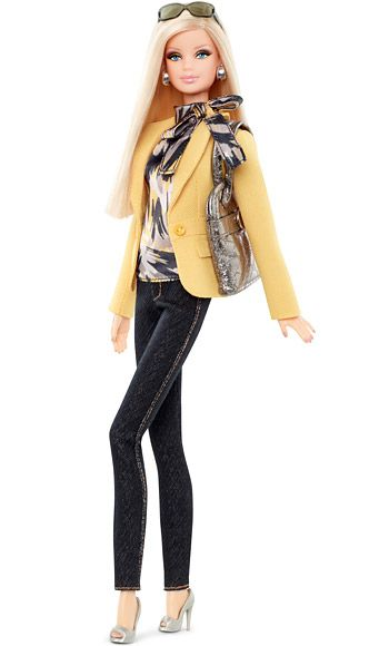 """Barbie Gets a Tim Gunn Makeover: Exclusive First LookBarbie's Casual LookBarbie is ready to """"make it work!"""" Dressed in her favorite skinny jeans, the $30 doll works a patterned blouse, yellow blazer, metallic purse, and must-have smartphone. $30 at barbiecollector.com and Target stores in August."""
