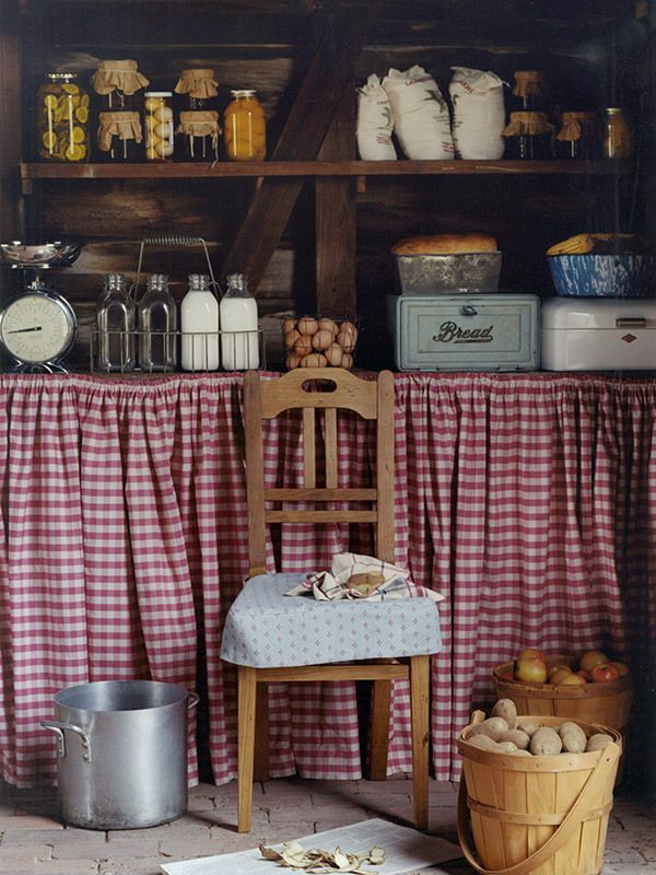 Farmhouse Kitchen With Red Check Cabinet Curtain.