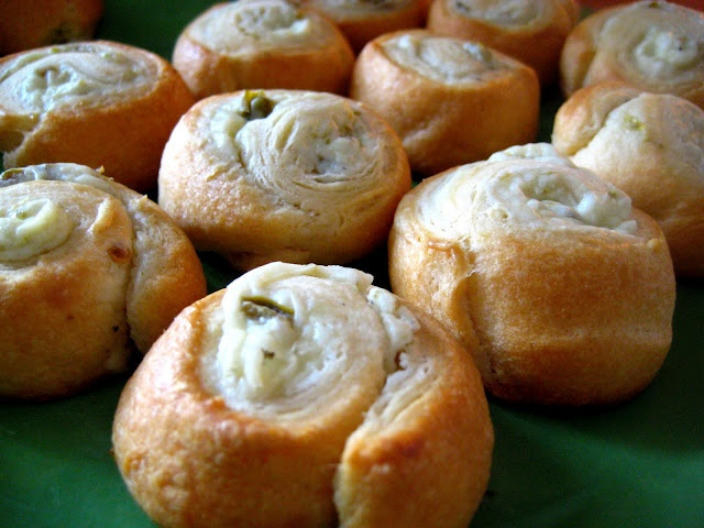 Jalapeno Crescent Poppers  just a can of diced peppers, a hunk of cream cheese, a tube of crescent rolls and a spoon of sugar