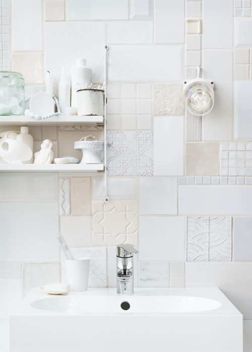 I kind of like the collage look of these tiles... I wonder if you could find scraps and/or samples for free or really cheep and do this for less than usual tiling...