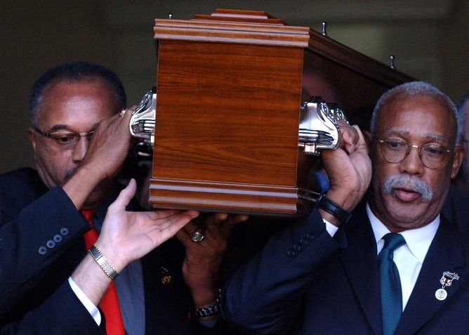 Tommie Smith and John Carlos carry the coffin of Peter Norman, 2006.