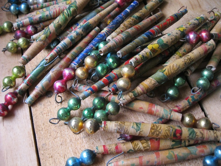 """I've been fascinated with paper beads since elementary school. Our librarian showed us how she made the hand rolled  beads, which she then made into jewelry. Here are some """"Vintage Rolled Paper Ornaments with Mercury Glass Balls"""" which sold on Etsy."""