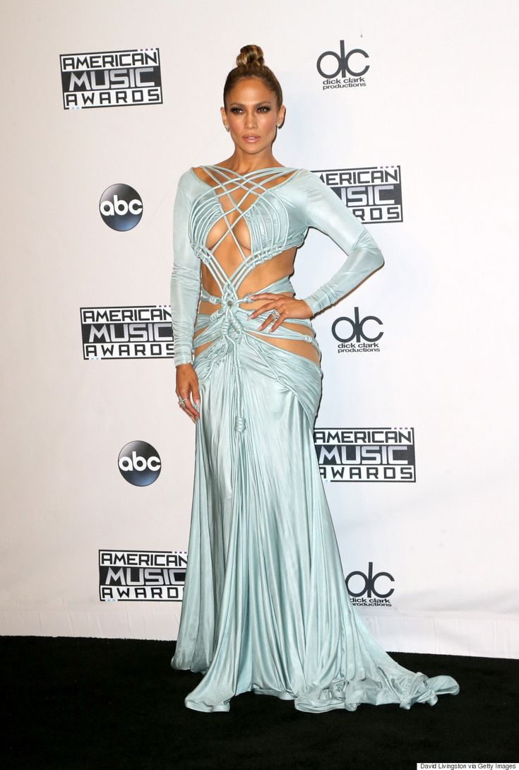 Jennifer Lopez posed in the press room in an ice blue Nicolas Jebran dress at the 2015 American Music Awards