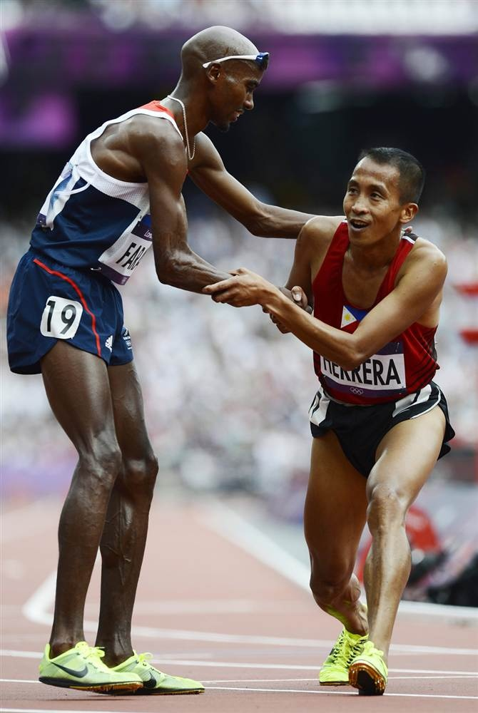 This is what the Olypmics are about.  Mohamed Farah of Britain, left, congratulates Rene Herrera of the Philippines after competing in the men's 5000m heats. Farah placed third in the first heat, while Herrera did not qualify for the final but clocked a personal best.