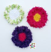 Instructions included for making flowers with Red Heart Scrubby yarn, regular cotton and acrylic yarn.