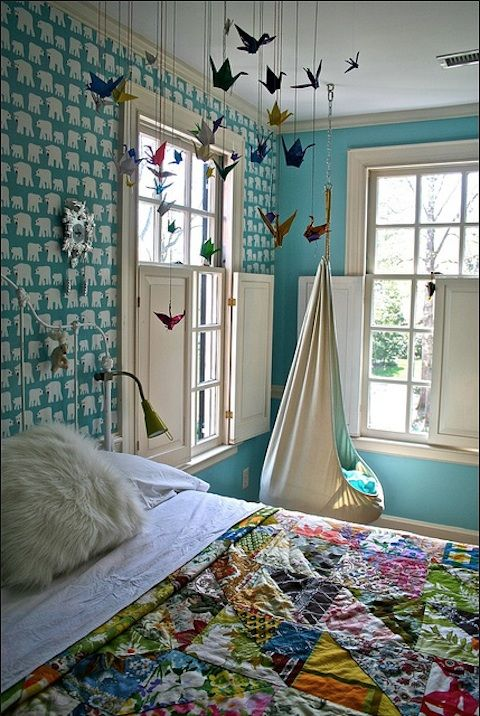 wallpaper, hammock chairs, paper crane mobiles, patchwork blankets... so much love right here!