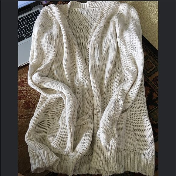 Brandy Melville cardigan Knit cardigan with small flaws as shown above. Pockets. Super comfortable. Brandy Melville Sweaters Cardigans