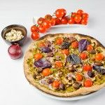 Vegan pine nuts and cherry tomatoes pizza.