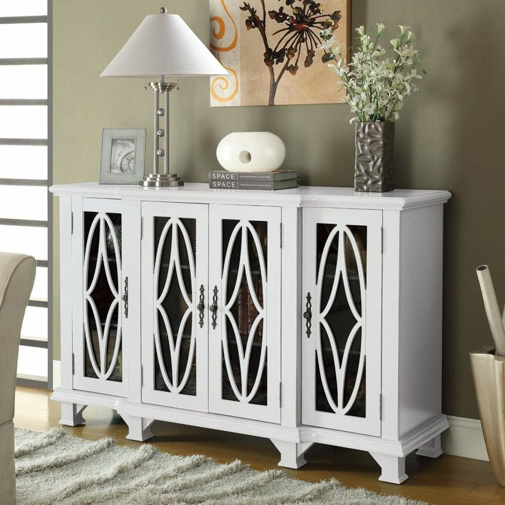 Coaster Large White Cabinet With 4 Glass Doors 950265 - Coaster Large White Cabinet With 4 Glass Doors 950265Bring a clean, transitional look and feel to your home with this large white cabinet. Grandly scaled, it has four glass doors with shelving behind. Each glass cabinet door features detailed wood carvings on the front for an eye-catching design with spunk. There are nine shelves total, offering plenty of space for your book collection, photo albums, movies, or whatever else you may…