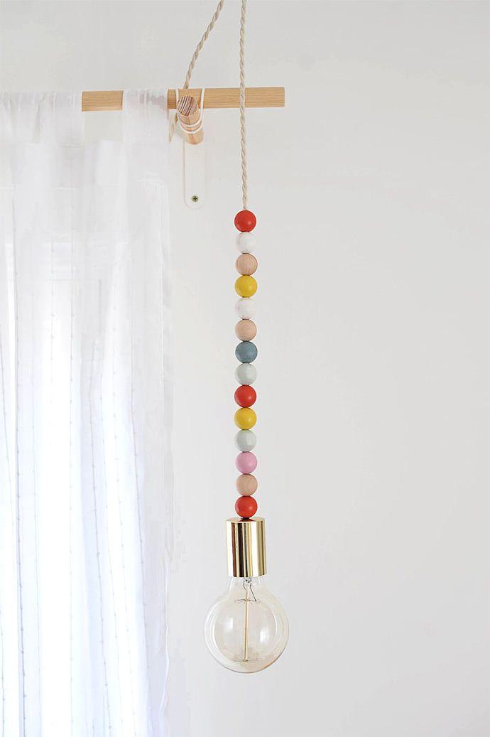 DIY Wooden Bead Pendant Light, tutorial via A New Bloom