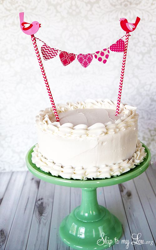 Heart Cake Bunting. Love it tied to striped straws. Hearts punched on folded over paper, way easier!