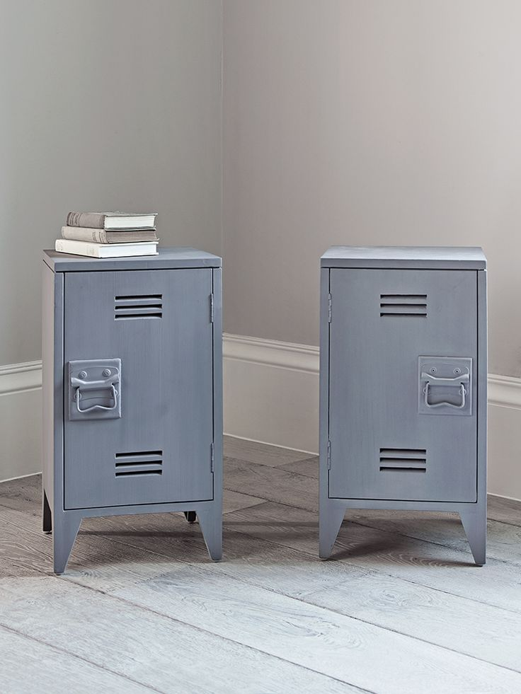 Inspired by old lockers, our pair of industrial style bedside tables have been carved from mango wood with a soft grey painted finish. Each tall weighty table includes a magnetic closing door that opens to reveal ample space for your bedside books and a removable inner shelf for versatile storage. Raised on four short tapered legs, our tables have a slightly rustic finish and include a vintage style handle. Perfect for bedside your bed, our vintage inspired tables also work well beside your…