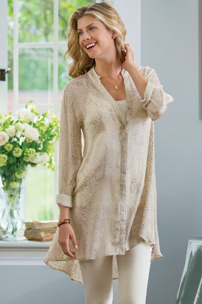 Our Textured Shirt subtly shimmers in a luxe silk with a trendy dropped-tail hem.