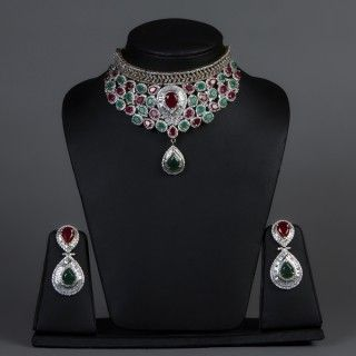 Featuring this beautiful Ruby necklace set with green stones in our wide range of Sets. Grab yourself one Now!