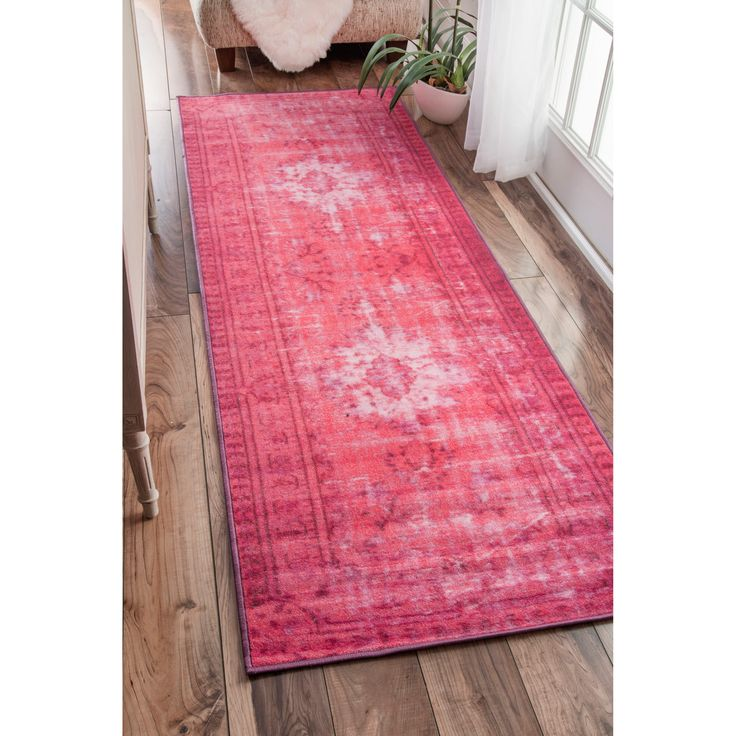 Made with 100% polyamide, this eclectic area rug is easy to clean and maintain.  The vibrant color that comes from overdying is sure to make this rug a standout in any room.