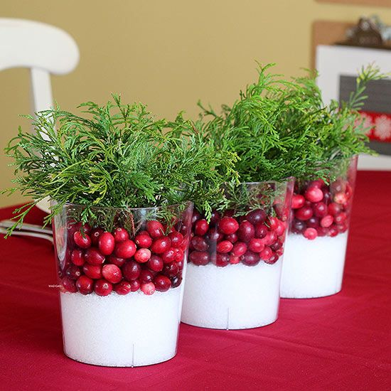 Easy Winter Cranberry Centerpiece . . .Fill a collection of clear glass bowls or vases with Epson salt. Two: Add a layer of bright red berries. Three: Fill the vessel with fresh or faux greenery. Cluster a collection of vases in the middle of your dining table.