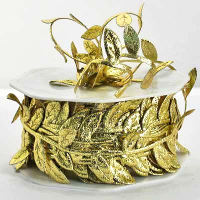 Satin leaves. #barama #giftpackaging #Giftwrapping #ribbons #presents #gifts #gold #leaves #christmasribbon #christmasdecoration #Christmas