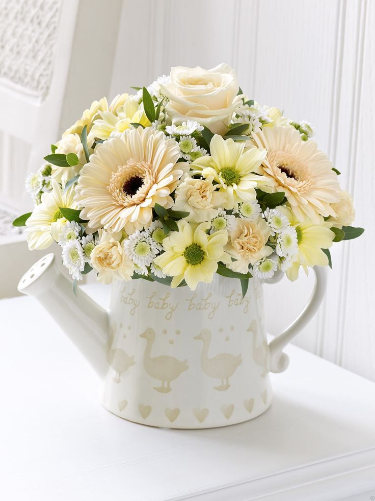 Perfect flowers for a new baby girl or boy in a cute duck motif watering can. From Venus Flowers,Manchester. Little Duckling Watering Can – Cream