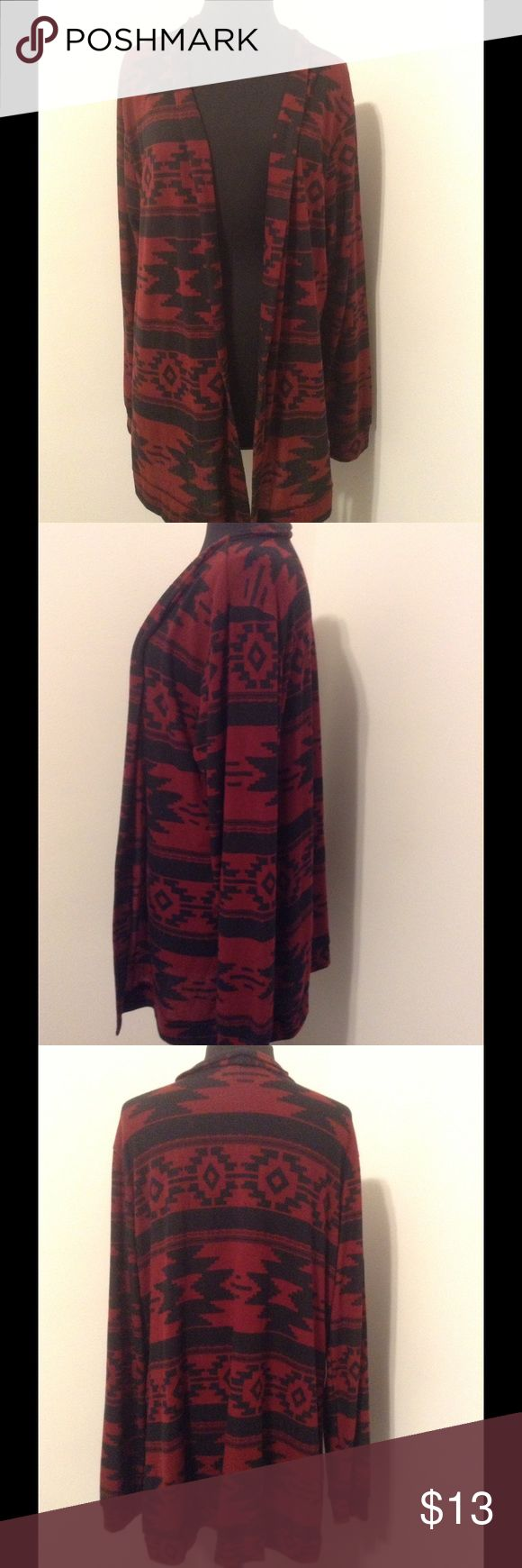 Womens Plus Bobbie Brooks Red Black Duster 3X Bobbie Brooks open duster/sweater/cardigan. Very nice. Has a southwestern pattern, long. Lightweight.   	•	95% polyester, 5% spandex 	•	Open duster 	•	Long sleeves 	•	red, black  	•	pre-owned and in very nice condition 	•	stretches 	•	machine wash 	•	necklace not included 	•	size 2X Always go by measurements provided rather than tag size. Measurements are around and taken while item is lying flat. 	•	Chest: open 	•	Waist:   open 	•	Hemline: open…