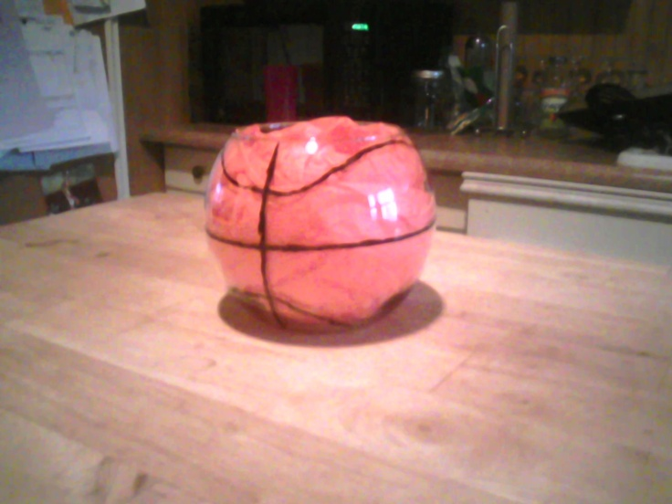 Centerpiece for high school basketball banquet. circle vase. drew lines on with paint pen and then filled vase with orange tissue paper.