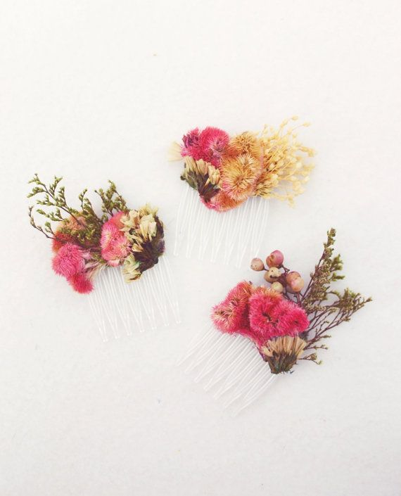 This set of three (3) hair picks is made with an arrangement of dried preserved flowers in shades of pink + cream, topped with green + creamy