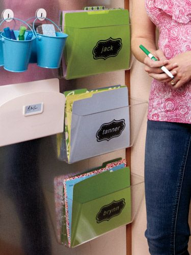 Turn an overlooked space into a multi-purpose hub!  Use colorful folders for each family member for superb organization.