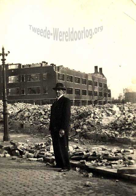 WW2 in the Netherlands - Rotterdam May 14th 1940 - Lusthofstraat. Mr. Martens standing in the ruines of the street he once lived.
