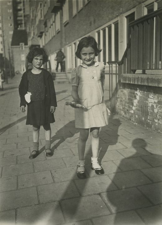 Anne Frank (right) with a friend  What a change after that picture........